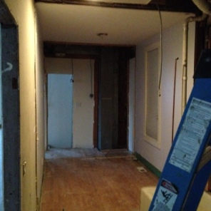 Under construction progress ~ demo of existing bath and laundry rooms {view into the old first floor bedroom}