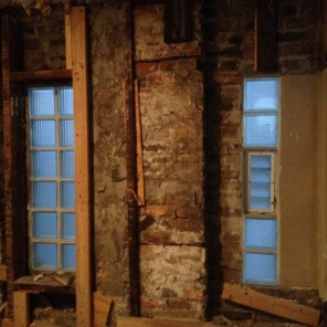 Under construction progress ~ exterior wall in old bathroom. Discovering old window openings