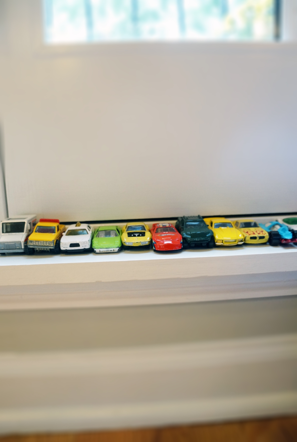 race cars on a ledge