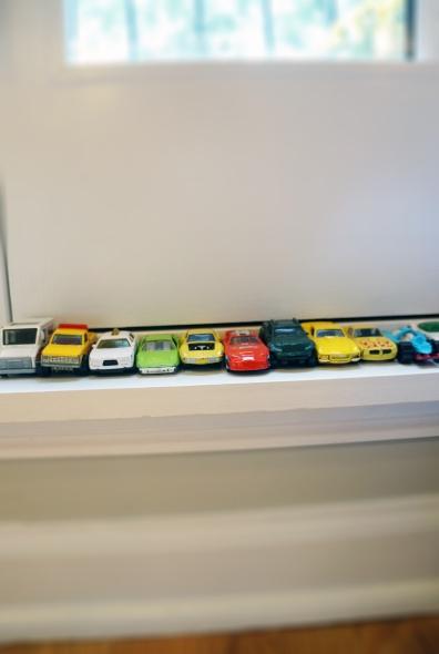 Baby boys' race cars on the ledge